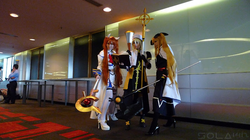 Comic Fiesta Day 1 cosplay the trio from Nanoha Strikers