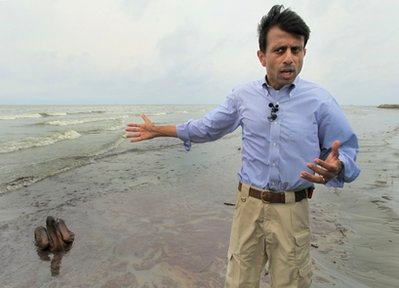 Louisiana Gov. Bobby Jindal talks to the media in front of a Brown Pelican mired in oil on the beach at East Grand Terre Island along the Louisiana coast, Thursday, June 3, 2010. AP Photo / Charlie Riedel