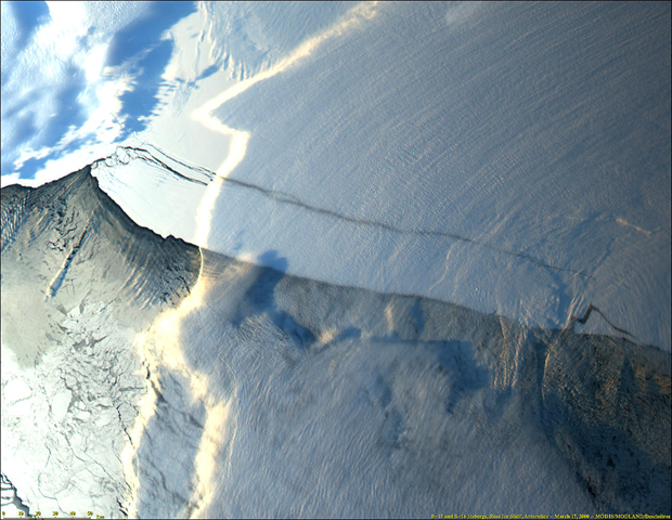 A massive iceberg, known as B-15, broke off the Ross Ice Shelf near Roosevelt Island in Antarctica in mid-March 2000. Among the largest ever observed, the B-15 iceberg is approximately 300 km long and 40 km wide an area about twice the size of the state of Delaware. The iceberg was formed from glacier ice moving off the Antarctic continent. The ice calved along pre-existing cracks in the Ross Ice Shelf. Jacques Descloitres, MODIS Land Science Team