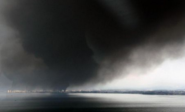 Smoke from one of the Fukushima nuclear plant explosions billows over the sea. crawlcraft.com