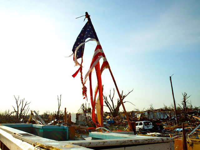 A shredded American flag stands in the wreckage of a church in Joplin, Missouri, 24 May 2011. AP / telegraph.co.uk