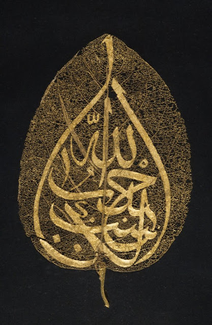 The inscription, written in gold in the form of a pear, may perhaps be read as &quot;Industry is next to godliness.&quot; The leaf stalk is also gold.