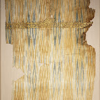 "he striped textiles of Yemen were famous in medieval times throughout the Islamic world. They were made in the ikat technique, in which the cotton warp threads were bundled together and resist-dyed before being arranged on the loom to form patterns of arrowheads and diamonds. The presence of fringe suggests that this fragment was part of a shawl. Inscriptions on Yemeni ikats are usually either embroidered or, as here, painted. These and other textiles bearing inscriptions were called tiraz, from the Persian word meaning ""embroidery."" They were produced in tiraz factories, some of which were commercial and others royal."