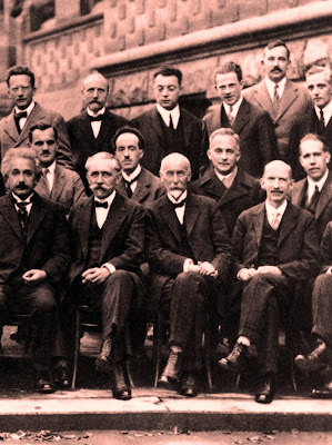 1927 Solvay Conference on Quantum Mechanics Photograph by Benjamin Couprie, Institut International de Physique Solvay, Belgium. Einstein is 1st from left in front row. Niels Bohr is middle row, 1st from right. Einstein and Bohr spent many years debating the nature of reality and the meaning of quantum physics.
