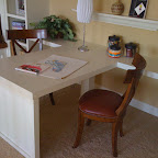 """Den study / work area. """"T"""" shaped desk ties into bookcases on either side. There is a bench seat on the left which I also built but didn't take a picture of."""