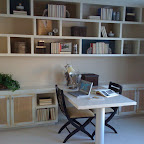 Bedroom activity area. A peninsula desk ties into storage cabinets. The book shelves above are attached through alternating solid backs which were wallpapered to match the wall creating a floating bookcase look.