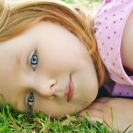 Smelling Grass by Cheryl Korotky - Babies & Children Child Portraits ( red hair, grass, a heartbeat in time photography, amazing faces, blue eyes, beautiful children, child model nevaeh, photo ideas for girls, red head, portrait )