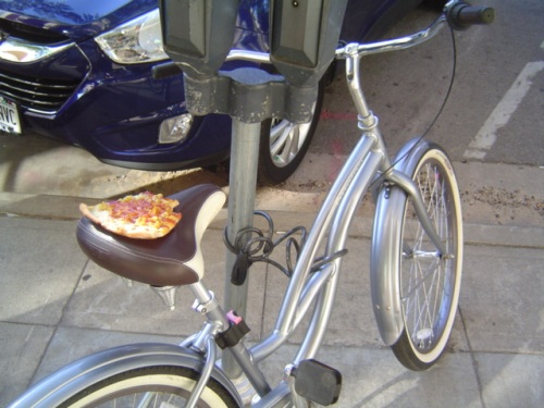 image of pizza on bicycle seat
