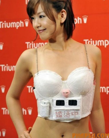 "Japan's lingerie maker Triumph International Japan campaign girl Hiromi Nishiuchi displays the ""Konkatsu Bra"" or ""Husband hunting Bra"" at the company's headquarters in Tokyo on May 13, 2009 to encourage women to hunt husband and buck the trend of women marriage late and staying single in Japan.  The bra has a marriage countdown clock and when she inserts her engagement ring in the heart-shaped ring rest affixed between the cups it stops the clock and plays a wedding song.    AFP PHOTO / Yoshikazu TSUNO (Photo credit should read YOSHIKAZU TSUNO/AFP/Getty Images)"