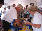 Claire cut's cheese at the New England Unit wine & cheese party.jpg