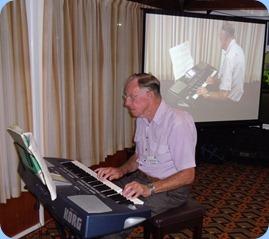 Len Osbourne playing his Korg Pa500 keyboard