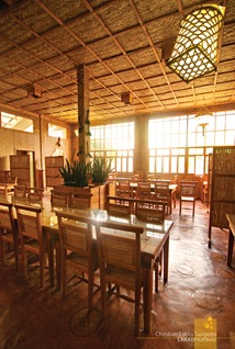 Warm Wooden Interiors Lighted with Floor to Ceiling Windows at Sagada's Rock Inn & Cafe