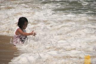 A Kid Playing Among the Waves at Saud's Pagudpud Beach