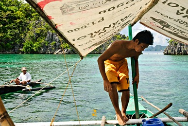 The Fee Collector Approaching our Boatman at Coron's Siete Pecados
