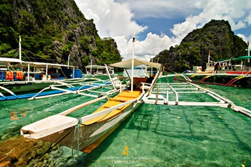 Our Boat Docked on Coron's Unbelievably Clear Waters