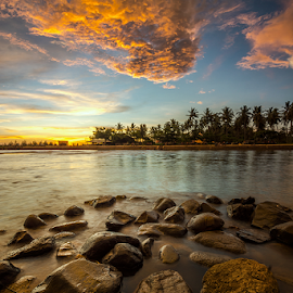Yellow Clouds by Ade Noverzan - Landscapes Sunsets & Sunrises ( clouds, sunset, beach, stones, dusk )