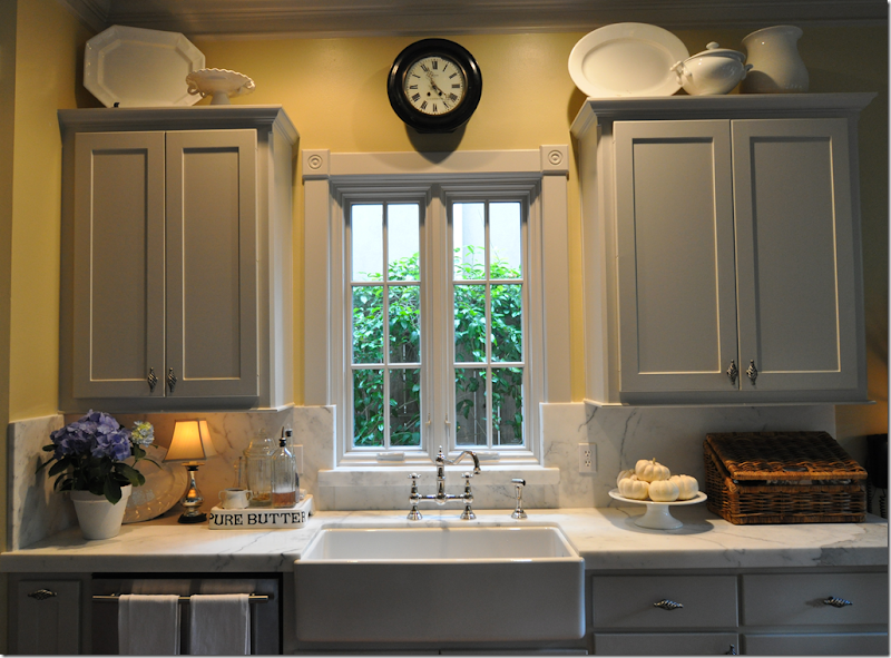 Cote de texas gray is the new turquoise for Blue kitchen cabinets with yellow walls