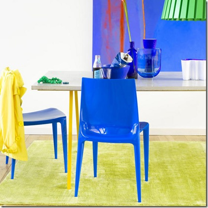 Bright bold blue dining room plastic chairs concrete table blue bowl vase abstract painting green rug L etc 06/2007 pub orig
