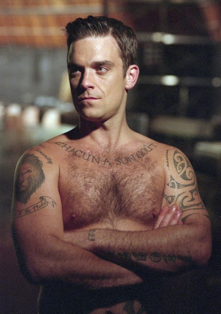 robbie williams torso showing off his tattoos and his hairy chest