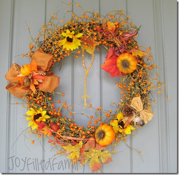 wreath on door JOY