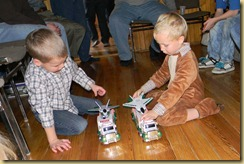 The boys playing with their Hess trucks from Santa 12/19/2010