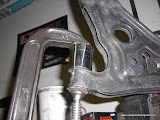 Using a C Clamp to remove the bushing