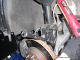 Removing the stock struts, bendign the brake line mount in the process