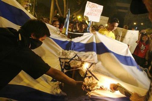 [gaza-attack-israel-flag-burned-2[3].jpg]