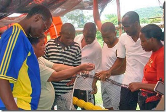 Rwandan trainees during the demonstration on assembling floaters for net cages and pens