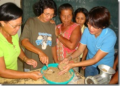 Dr. Mae Catacutan (rightmost) demonstrates aquafeed formulation during the practical session