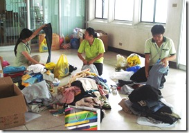 AQD employees sort out donations before turning them over to GMA Foundation