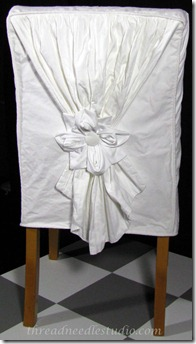white drape slipcover back