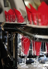 image of a limo's bar showing crystal glassware and red napkins, ©J. Gracey Stinson