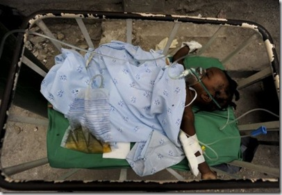 A child treated at the #Haiti Doctors Without Borders run Carrefour hospital recovers in a quiet area after she is stabilized. © Julie Remy