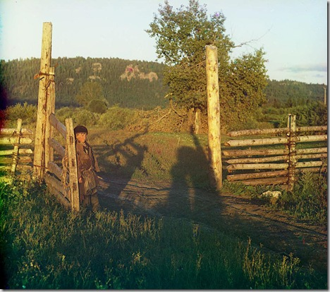 Boy standing by wooden gatepost; 1910 Sergei Mikhailovich Prokudin-Gorskii Collection (Library of Congress).