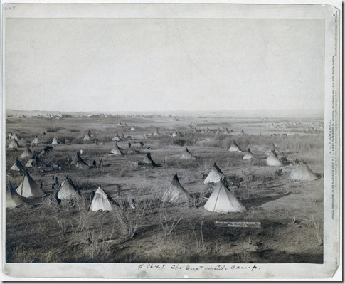 Title: The Great Hostile Camp Bird's-eye view of a Lakota camp (several tipis and wagons in large field)--probably on or near Pine Ridge Reservation. 1891. Repository: Library of Congress Prints and Photographs Division Washington, D.C. 20540