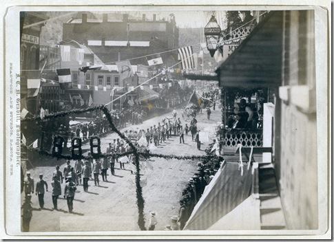 "Title: People of Deadwood celebrating completion of a stretch of railroad Street parade with numbers ""1888"" in foreground. 1888. Repository: Library of Congress Prints and Photographs Division Washington, D.C. 20540"