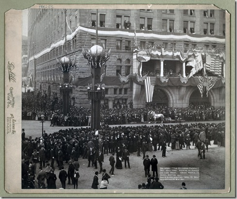 Title: The Columbian Parade. Oct. 20th, 1892. Forming of parade on lake front. 100,000 people in sight. Section No. 1 Spectators lined up along street; buildings and street lights decorated with flags. Repository: Library of Congress Prints and Photographs Division Washington, D.C. 20540