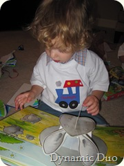 rals with kim's book - happened to open to his fave - the rhino!