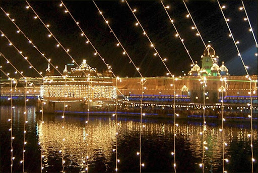 amritsar golden temple diwali. An illuminated Golden Temple
