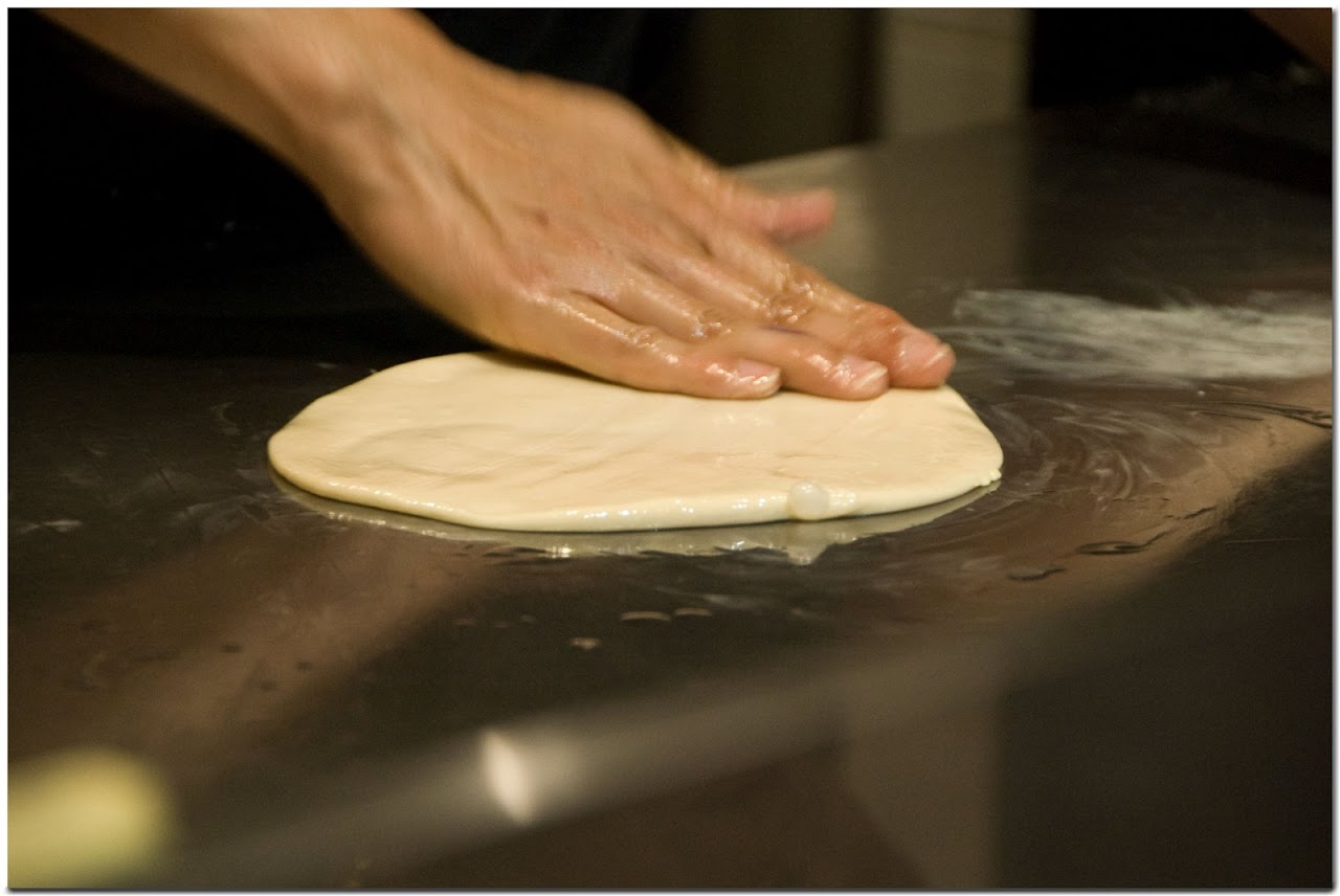 Flattening roti dough