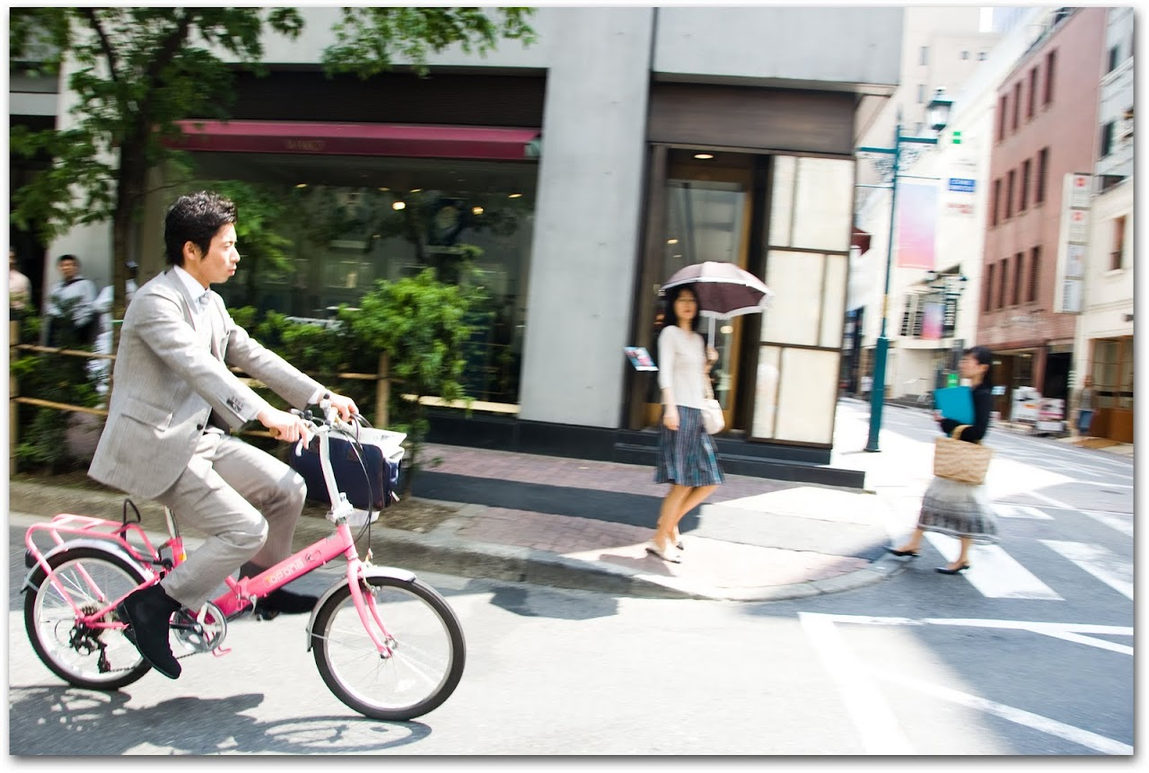 Man on a pink bike