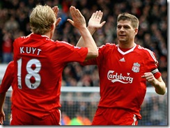 Kuyt and Gerrard celebrate