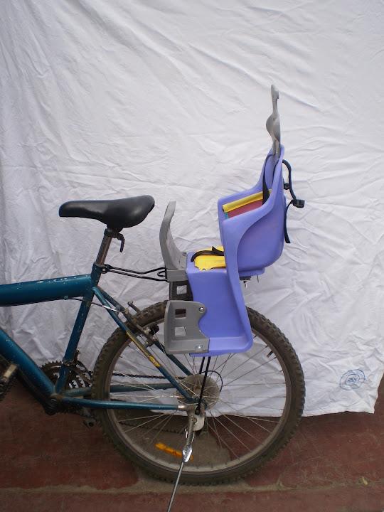 Silla para llevar ni os en bicicleta silla de paseo for Silla nino bicicleta