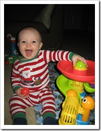 He loves this toy!  (And yes, I still put him in his cute Christmas PJs! :) 1-28-10