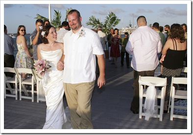 """This is one of my favorite wedding pictures. We are walking down the isle after getting married.  I think I was saying, """"Can you believe it, Stinker?!  We just got MARRIED!!""""  :)"""