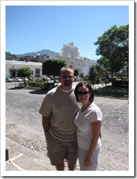 Jer & Jenny with the church G&M were married in in the background.