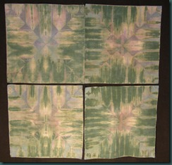 Four broadcloth squares folded and dyed