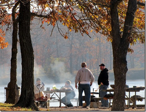 Grandpa, Son, and Grandsons enjoying autumn weekend breakfast and fishing at the lake