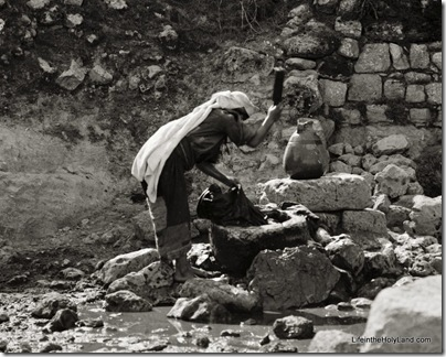 Women washing clothes at fountain, mat05312